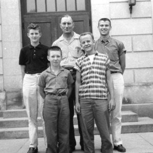 Four boys and an older man posing during North Carolina State 4-H Club Week