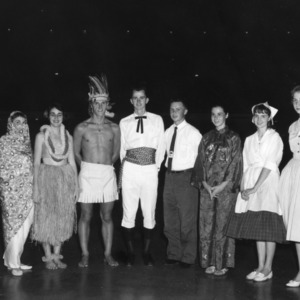 4-H club members in costume demonstrating international dress styles, during North Carolina State 4-H Club Week