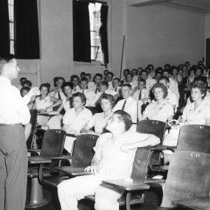 Man speaking before 4-H club members, during North Carolina State 4-H Club Week