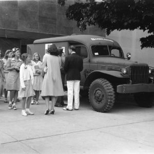 4-H club members looking at the ambulance presented to the United States Army Medical Department in honor of former 4-H club members serving in the armed forces