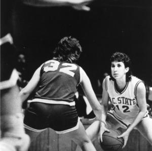 N.C. State's #12 Debbie Mulligan faces off against Duke(?) opponent during women's basketball game