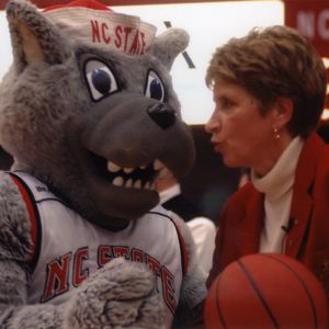 Kay Yow with Mr. Wuf at women's basketball game