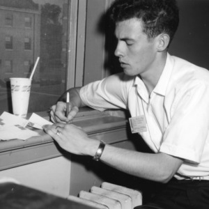 Lowell Crawford of Macon County writing letters from his dorm room in Alexander Hall, during North Carolina State 4-H Club Week