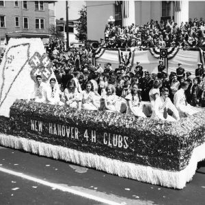 4-H club members riding on a float in a parade in Wilmington, North Carolina