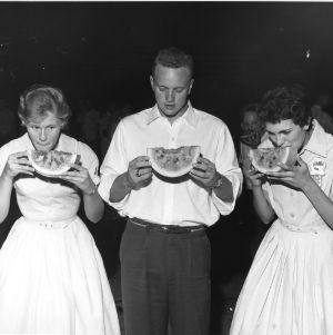4-H club members eating watermelon at North Carolina State 4-H Club Week