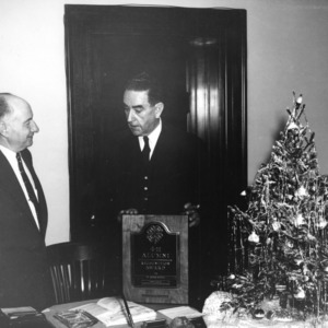 L. R. Harrill and Governor W. Kerr Scott conversing at 4-H Alumni event