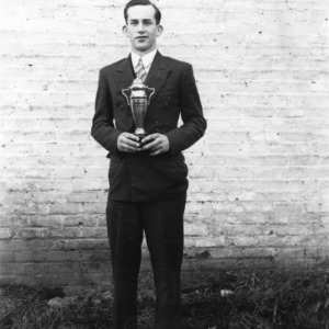 4-H club member holding a trophy