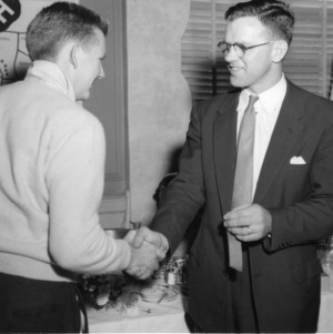 4-H club member shaking hands with unidentified man