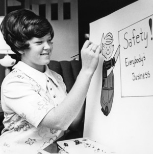 4-H club girl drawing a safety poster as part of a 4-H safety exhibit in Salisbury, North Carolina