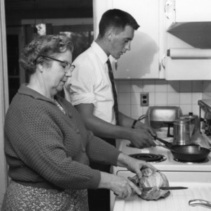 Young man helping to cook while participating in the International Farm Youth Exchange program in Craven County, North Carolina