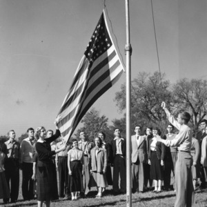 4-H club girl and boy raising the American flag as part of the 4-H citizenship program