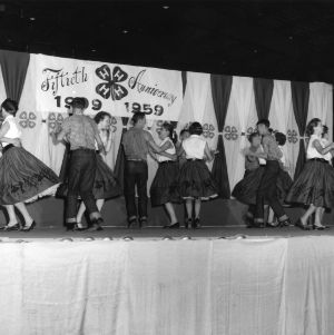 4-H club members dancing together in celebration of the fiftieth anniversary of 4-H