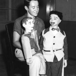 4-H club boy performing with two ventriloquist dummies as part of the 4-H communication and art program