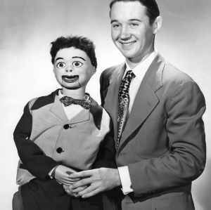 4-H club member posing with his ventriloquist dummy as part of the 4-H communication and art program