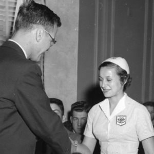 4-H club member shaking hands with an unidentified man