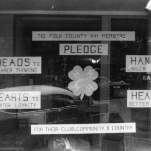 4-H club window exhibit created by Polk County, displaying the 4-H Pledge
