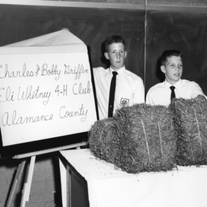 Competition winners Charles and Bobby Griffin, of the Eli Whitney 4-H Club, Alamance County, North Carolina, during North Carolina State 4-H demonstration competition, 1960
