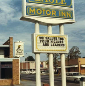 "Motel sign congratulating 4-H clubs, it reads ""We Salute the Four H Clubs and Leaders"""