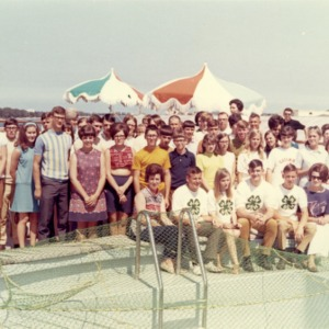 4-H club members standing in front of a pool while on a cruise