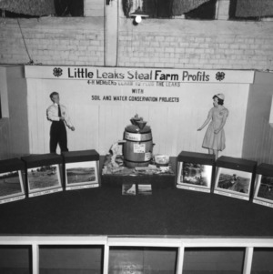 "4-H club exhibit, ""Little Leaks Steal Farm Profits,"" at North Carolina State Fair, 1958"