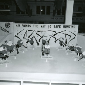 "4-H club exhibit, ""4-H Points the Way to Safe Hunting,"" at North Carolina State Fair"