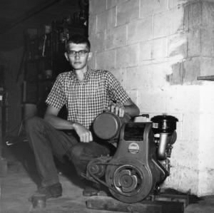 4-H club member Frank Summer of 4-H small engine project, 1971