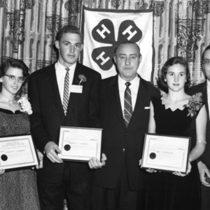 4-H club members Dorothy Chambers, Edward C. Garner, and Ann Thomason receiving Territorial Achievement Awards for 4-H electric project