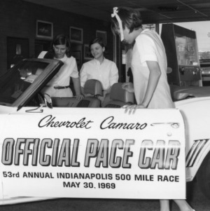"Cleveland County, North Carolina, 4-H Club automotive program members inspecting a Chevrolet Camaro, ""Official Pace Car, 53rd Annual Indianapolis 500 Mile Race, May 30, 1969."""