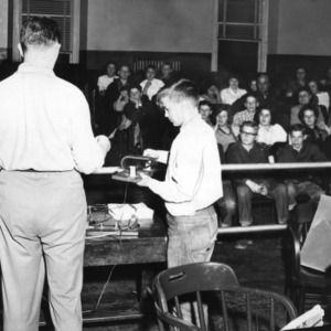 4-H club electric workshop, Joe Howard (back to camera), 1958