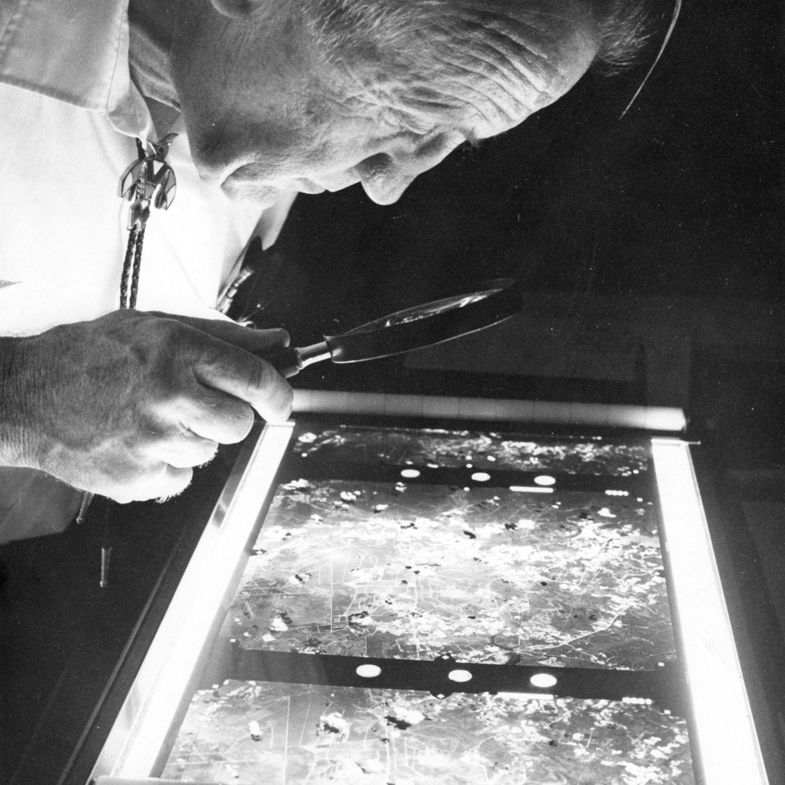 Unknown person examining aerial photographs