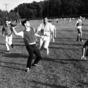 Students play in an intramural football game
