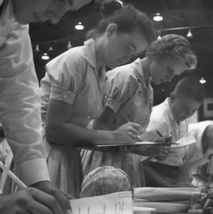 4-H club members judging vegetables during North Carolina State 4-H Club Week, July 1959