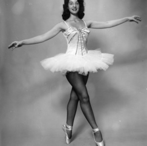 4-H club member posing on pointe in her ballet costume for a North Carolina State 4-H Club Week performance at North Carolina State College in Raleigh