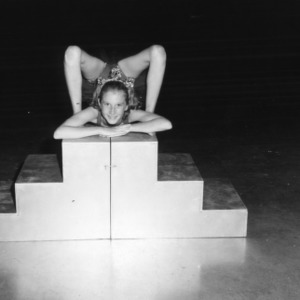 4-H club girl performing acrobatics at North Carolina State 4-H Club Week at North Carolina State College in Raleigh