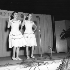 Two 4-H club girls singing and dancing in a performance at North Carolina State 4-H Club Week at North Carolina State College in Raleigh
