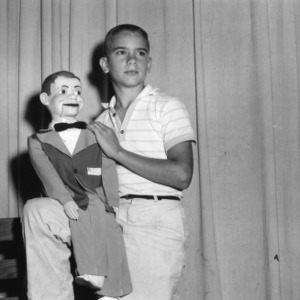 4-H club boy performing as a ventriloquist at North Carolina State 4-H Club Week at North Carolina State College in Raleigh