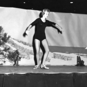 4-H club girl tap dancing in a performance at North Carolina State 4-H Club Week at North Carolina State College in Raleigh