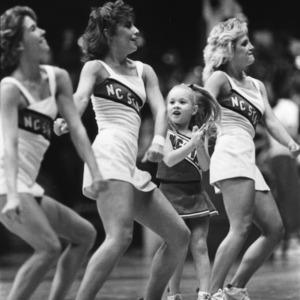Wolfpack cheerleaders with mini cheerleader