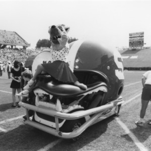 Ms. Wuf riding Wolfpack helmet go-cart