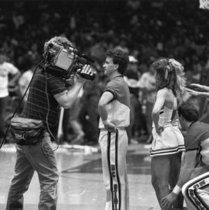 Camera man recording cheerleaders