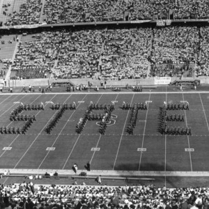 """N.C. State marching band spells out """"STATE"""""""