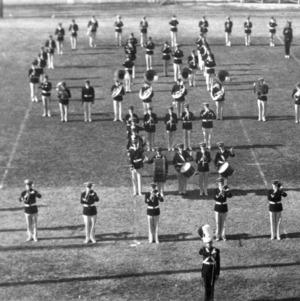 "Marching band making ""NCSU"" symbol"