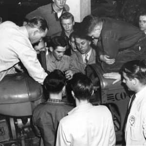 4-H club members examining a tractor at tractor school in 1952