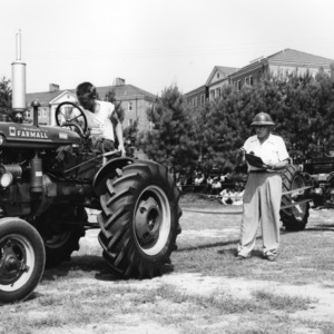 4-H club member driving his tractor while being judged at a tractor contest