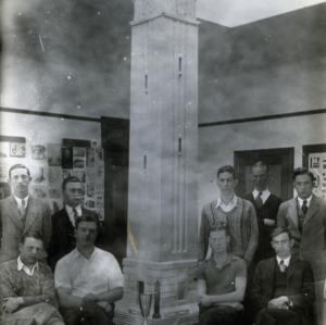 Students pose with model of Memorial Tower