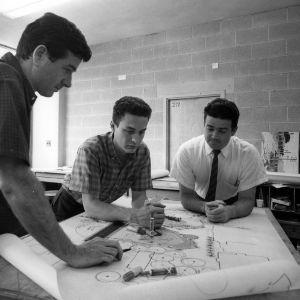 Architectural design students observe blueprint