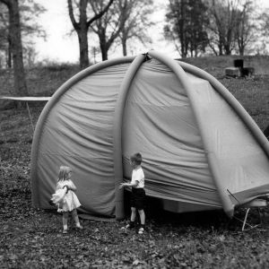Children playing outside of tent