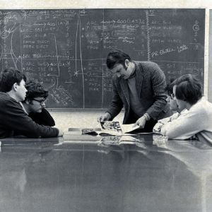 Architecture professor Robert P. Burns advising students