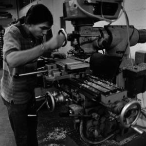Design student operating machinery