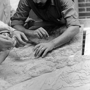 Design student viewing a landscape model
